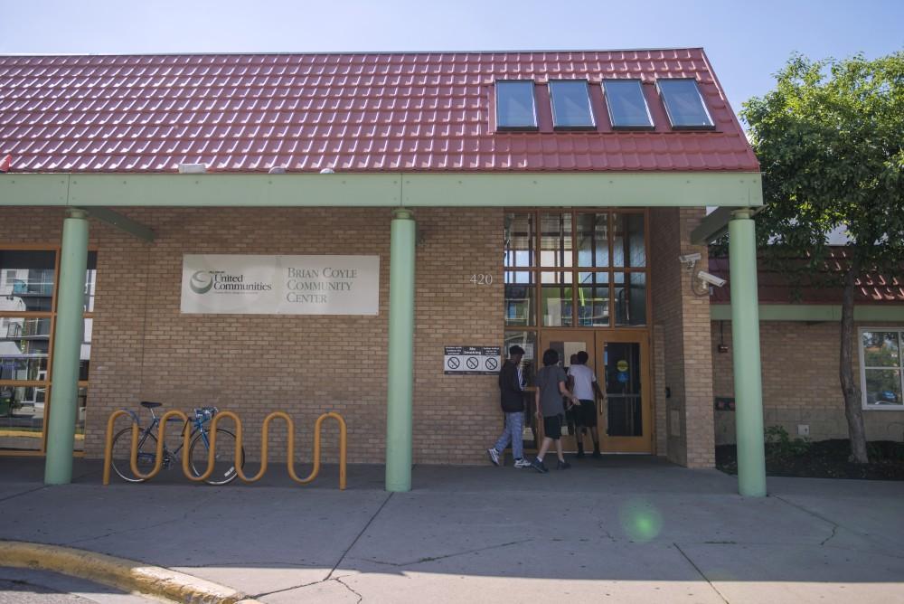 Kids enter the Brian Coyle Community Center on June 15, 2017.