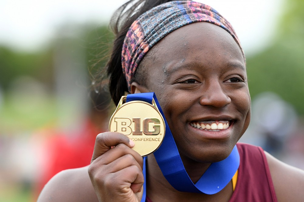 <p>Temi Ogunrinde holds up a medal during the Big Ten Championship on May 12, 2017. </p>