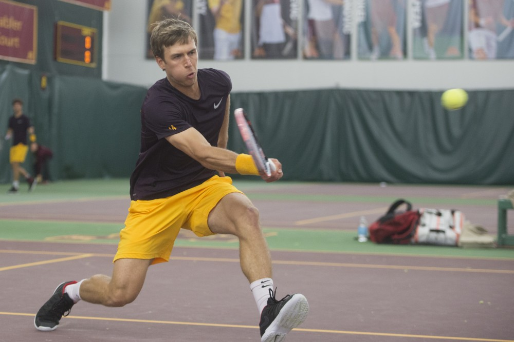 Matic Spec returns the ball during a match against Ohio State University at Baseline Tennis Center on Friday, March 30.