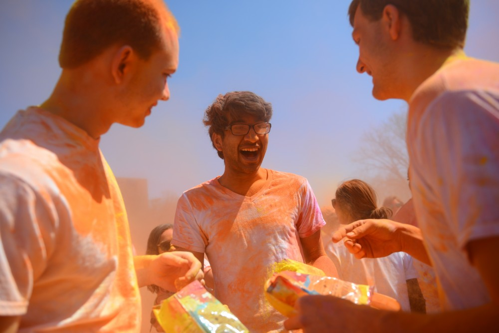 Satish Uppaluri center, with friends minutes after color is thrown into the air on Sunday, April 29.