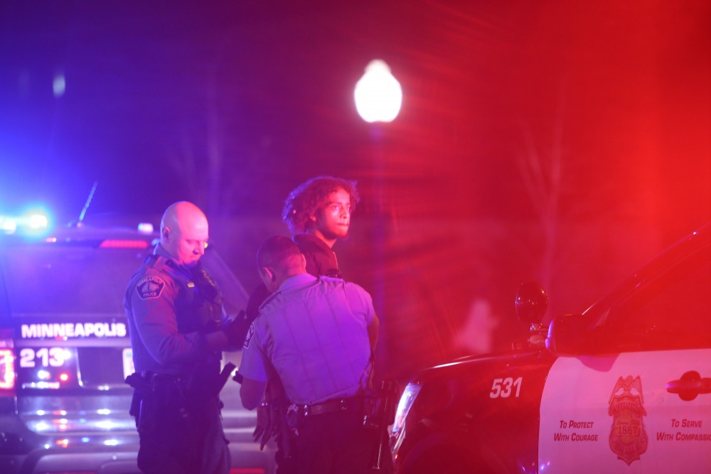 Officers arrest a suspect outside Northrop on Friday, April 20, 2018. The Minneapolis Police Department and University of Minnesota Police Department responded to a disturbance at Northrop following the Somali Student Association's Somali Night event.