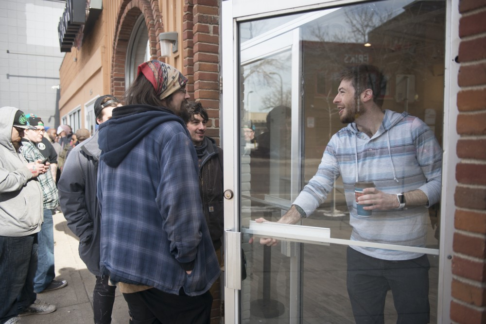 Hideaway manager Brandon Lerold opens the doors to a line of eager customers.
