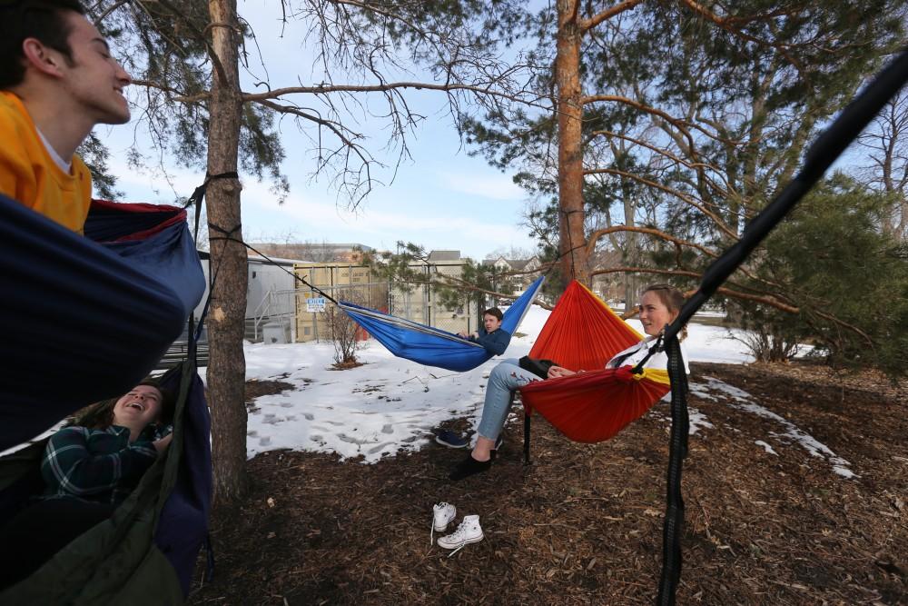Freshmen Justin Lupa, Megan McCartan, Emily Walgren and Paul Hodowanic relax in their hammocks after class is done.