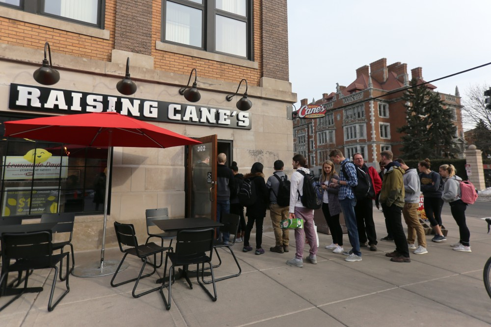 The line extends out the door of Raising Cane's  in Dinkytown.