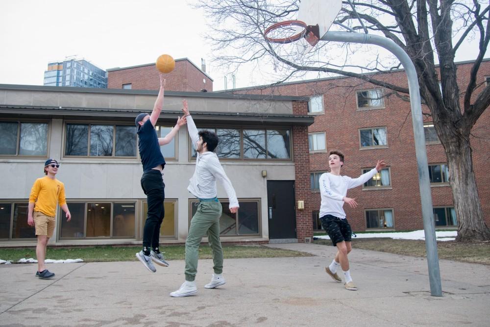 UMN freshmen Gabe Villalobas, Keaton Skaja, Zane Murphy, and Eric Pettett play basketball outside of Territorial Hall.