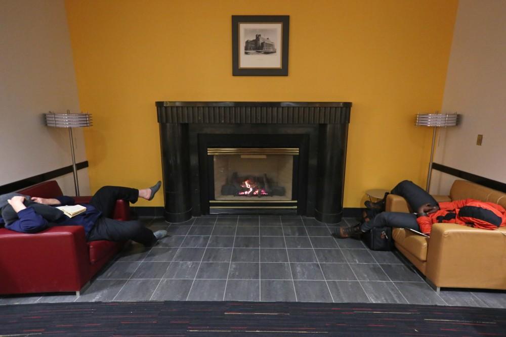 Two men sleep in Coffman Union.