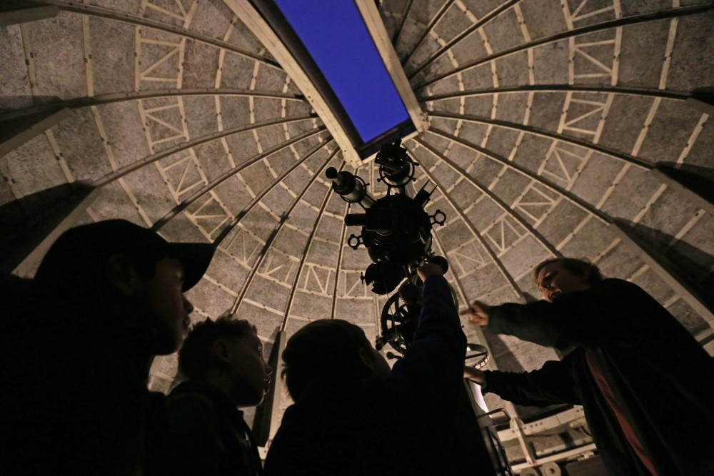 The group that came for Telescope Observation Night takes 20-person shifts inside the observatory in John T. Tate Hall.