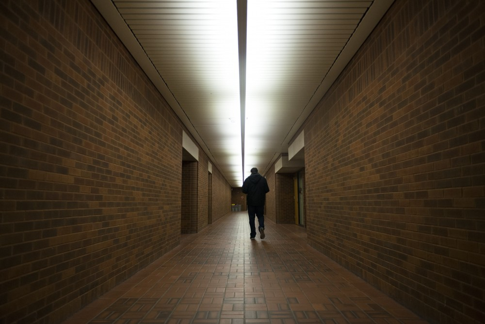 A student walks in the tunnels below West Bank.