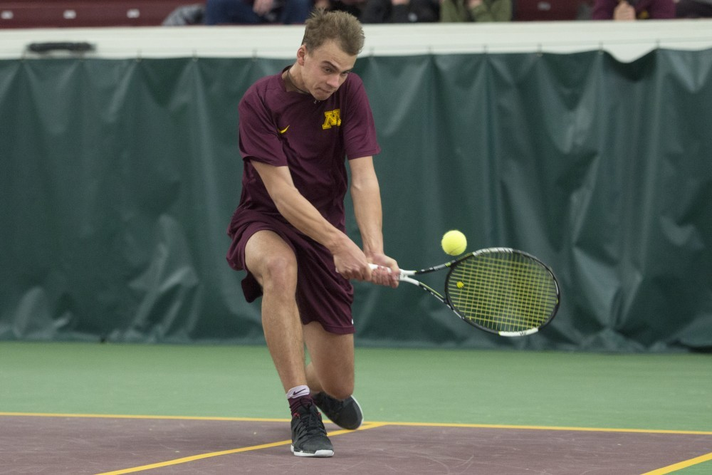Freshman Vlad Lobak returns the ball during his doubles match with partner Eli Ogilvy against the University of Pennsylvania at the Baseline Tennis Center on Sunday, Feb. 25.