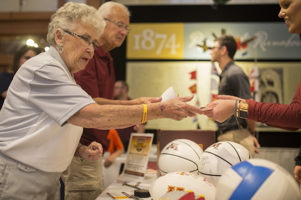 Betty Ostlund enters a drawing to win signed merchandise during the Gopher Road Trip at the Legacy of the Lakes Museum on Thursday, May 24, 2018 in Alexandria, Minnesota.