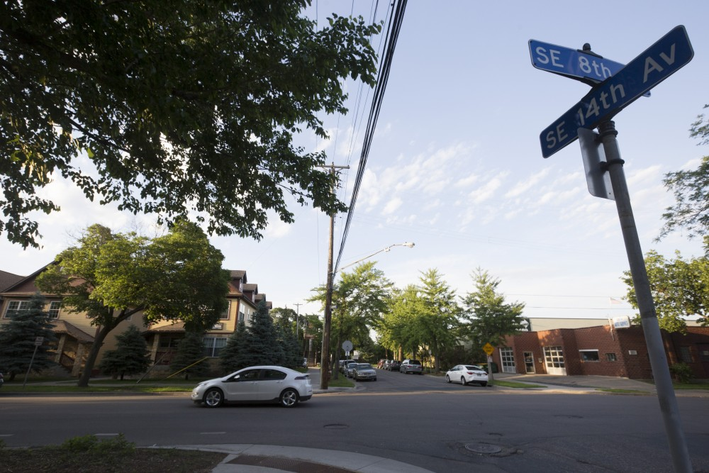 A car drives past the intersection of 8th Street and 14th Avenue Southeast on Monday, June 4 in Dinkytown.