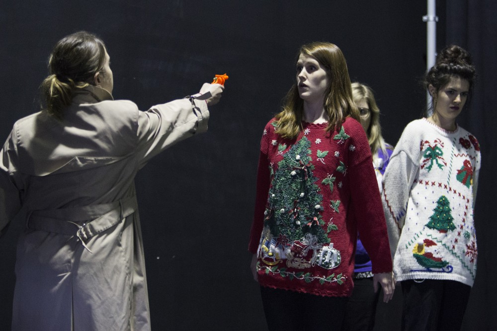 Pauline Johnson points a water gun at fellow Ladybrain Sketch Comedy members Amie Durenberger, Gabby VandenAvond and Lauren Chestnut during a rehearsal for the group's upcoming performance at Strike Theater on Monday, June 4 in Northeast Minneapolis. The group rehearsed a sketch poking fun at the length of a