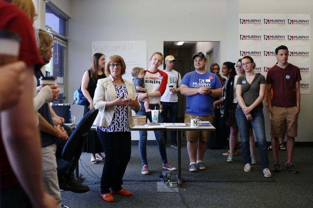 DFL-endorsed candidate for Minnesota Governor Erin Murphy speaks to attendees at a rally to begin her campaign door knocking kick off event in Prospect Park on Saturday, June 9.