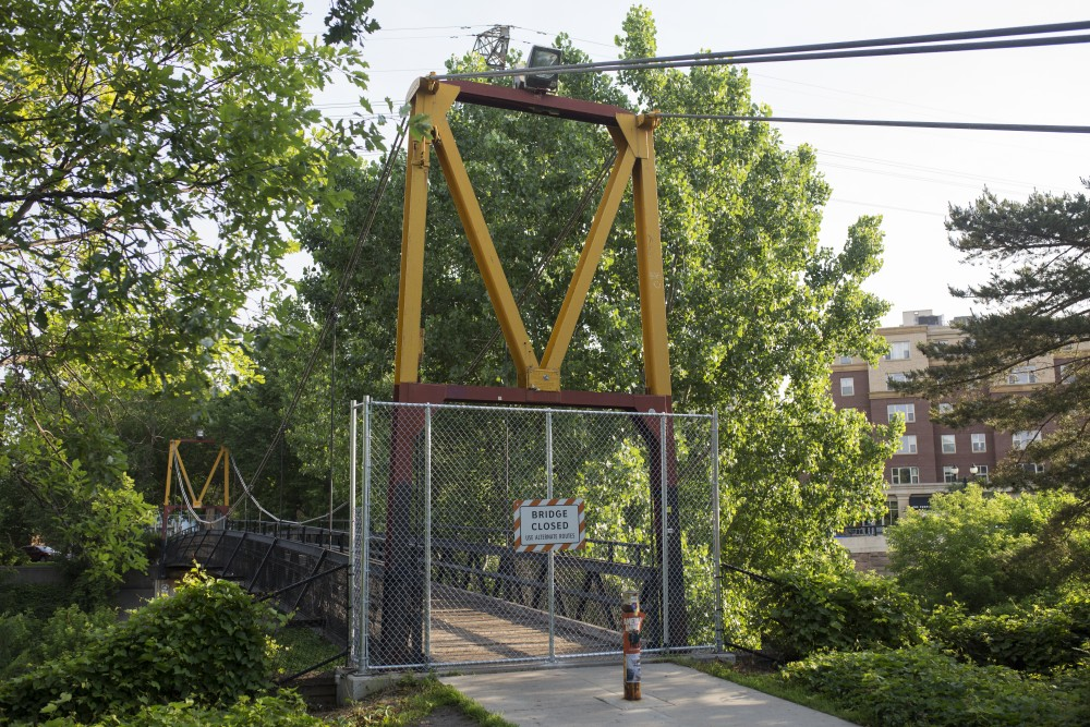 A view of the pedestrian suspension bridge located east of Roy Wilkins Hall on Friday, June 15. The University is deciding if it will be replaced.