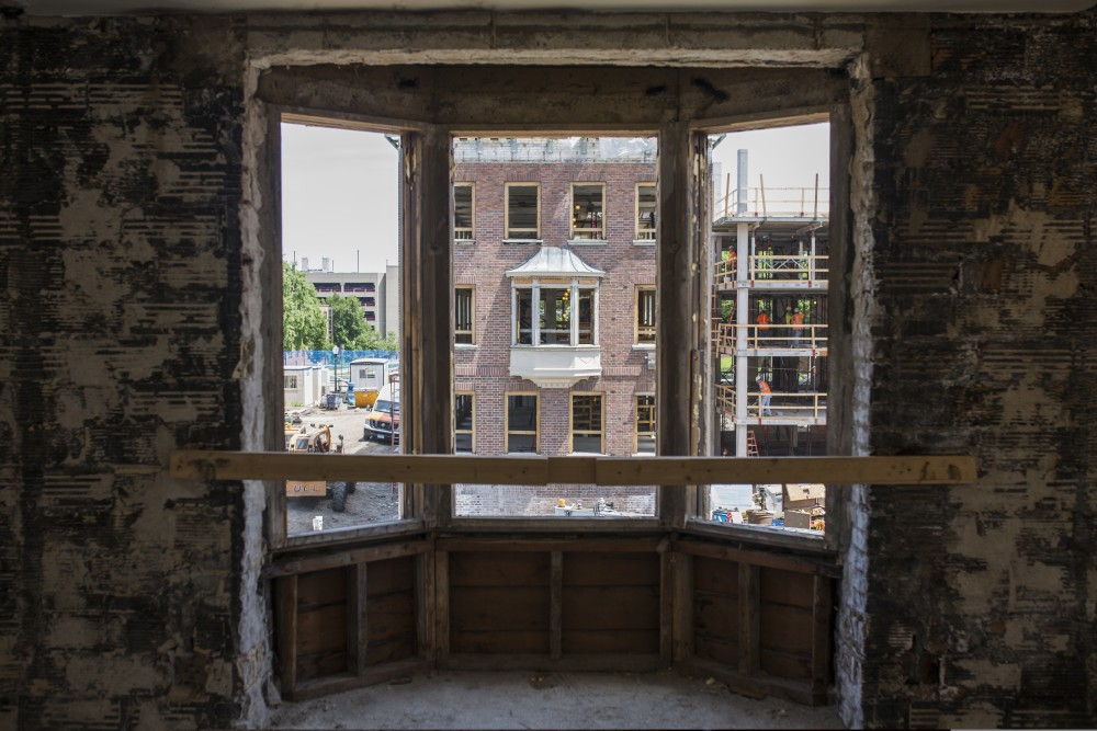 A view from the third floor of Pioneer Hall looking through a bay window during the dormitory's renovation on Thursday, June 14.