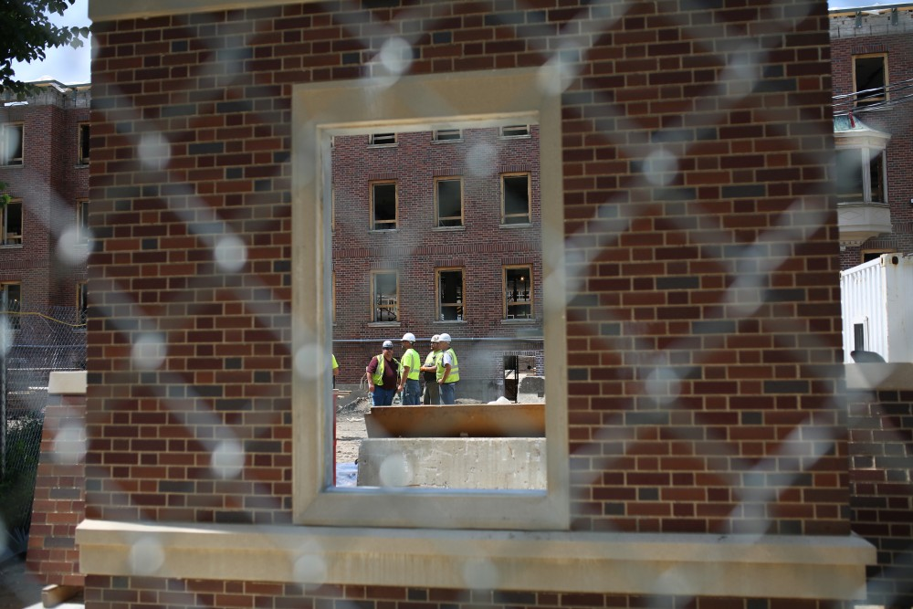 A view through a mock model of wall made to match the existing historic brick outside of Pioneer Hall on Thursday, June 14.