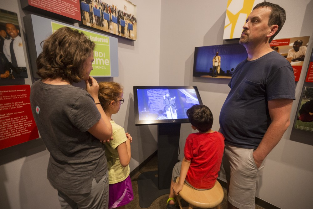 Miriam Meyer, left, Salome Meyer, Silas Meyer and Joab Meyer watch a video that is part of the History Center's new