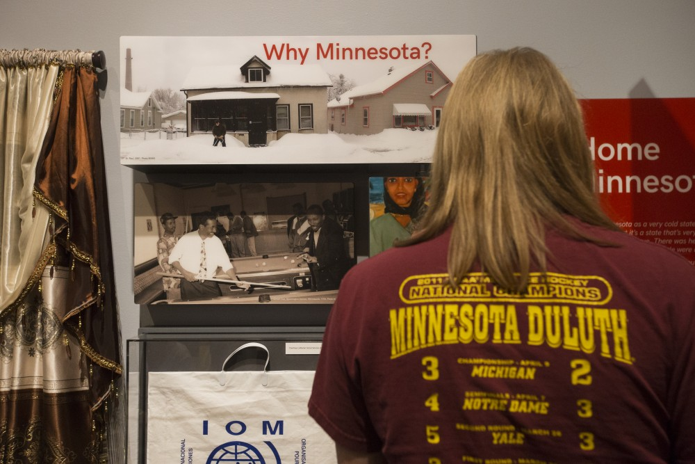 Viewers stop to read details at the History Center's new