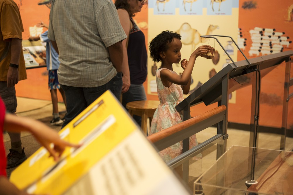 Amran Mohamed, 5, interacts with the History Center's new