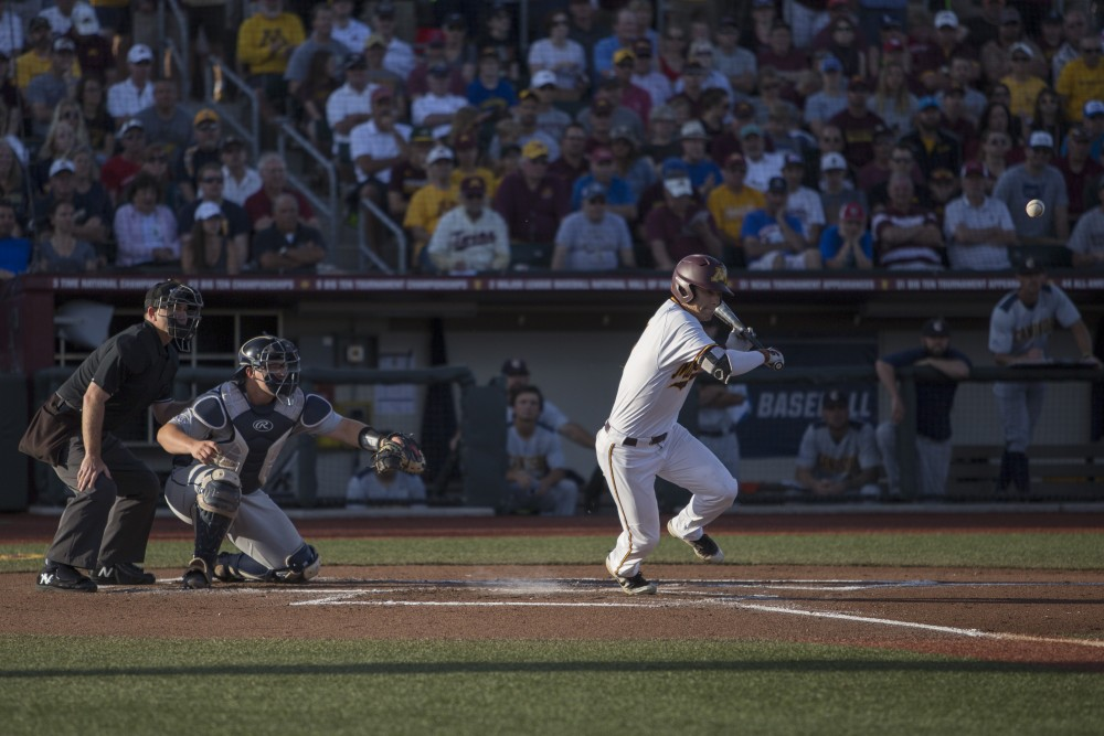 Catcher Eli Wilson successfully hits a pitch during the game against Canisius on Friday, June 1, 2018 at Siebert Field. The Gophers won 10-1.
