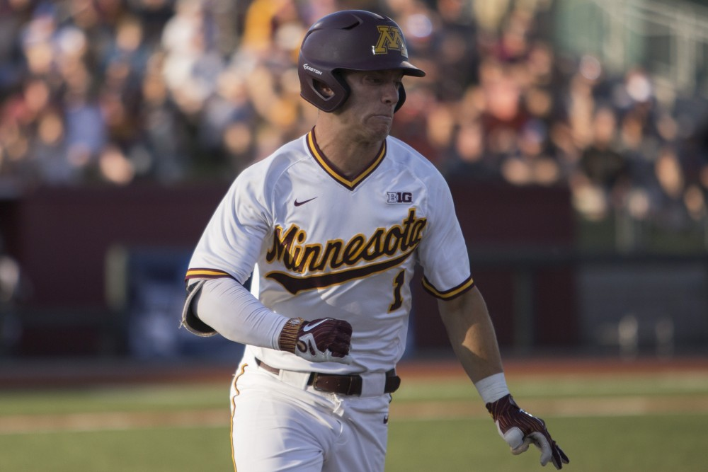 Outfielder Ben Mezzenga runs to first base during the game against Canisius on Friday, June 1, 2018 at Siebert Field. The Gophers beat Canisius 10-1.