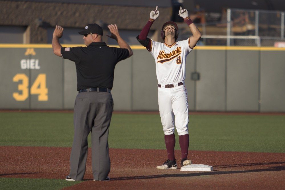 Micah Coffey signals after hitting a double during the game against Canisius on Friday, June 1, 2018 at Siebert Field. The Gophers won 10-1.