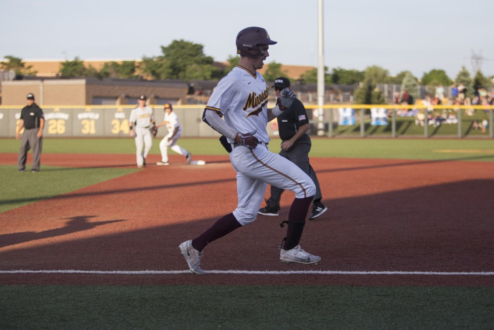 Outfielder Alex Boxwell runs through first base during the game against Canisius on Friday, June 1, 2018 at Siebert Field. The Gophers beat Canisius 10-1.