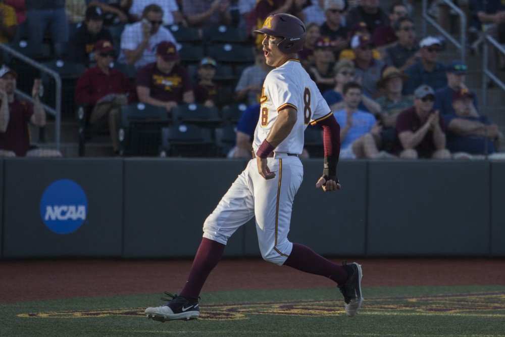 Infielder Micah Coffey celebrates as he runs through home plate during the game against Canisius on Friday, June 1, 2018 at Siebert Field. The Gophers beat Canisius 10-1.