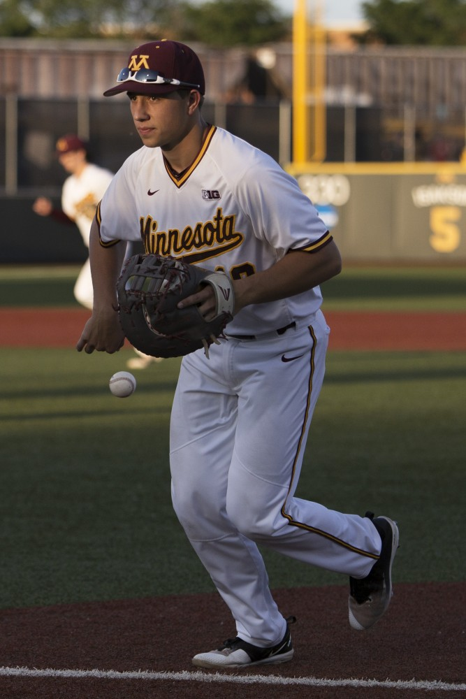 First baseman Cole McDevitt catches a ball as he runs into the dugout between innings during the game against Canisius on Friday, June 1, 2018 at Siebert Field. The Gophers beat Canisius 10-1.