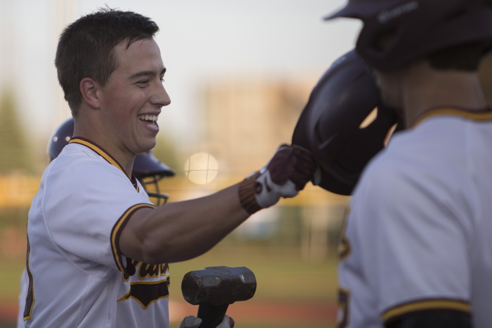 Cole McDevitt is congratulated after hitting a home run during the game against Canisius on Friday, June 1, 2018 at Siebert Field. The Gophers won 10-1.