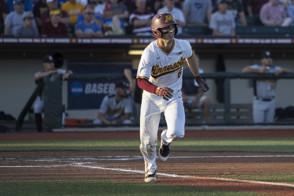 Infielder Terrin Vavra runs to first base after hitting a single during the game against Canisius on Friday, June 1, 2018 at Siebert Field. The Gophers beat Canisius 10-1.
