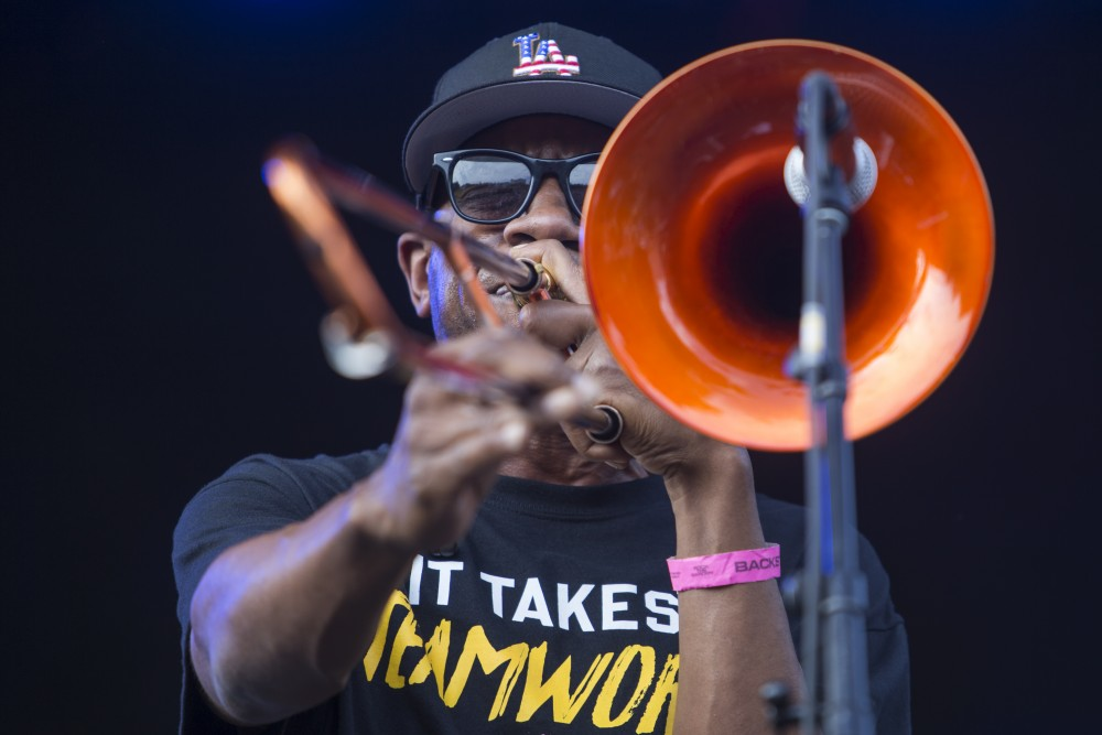 Trombonist Ryan Porter shares the stage with Kamasi Washington at Rock the Garden on Saturday, June 16.