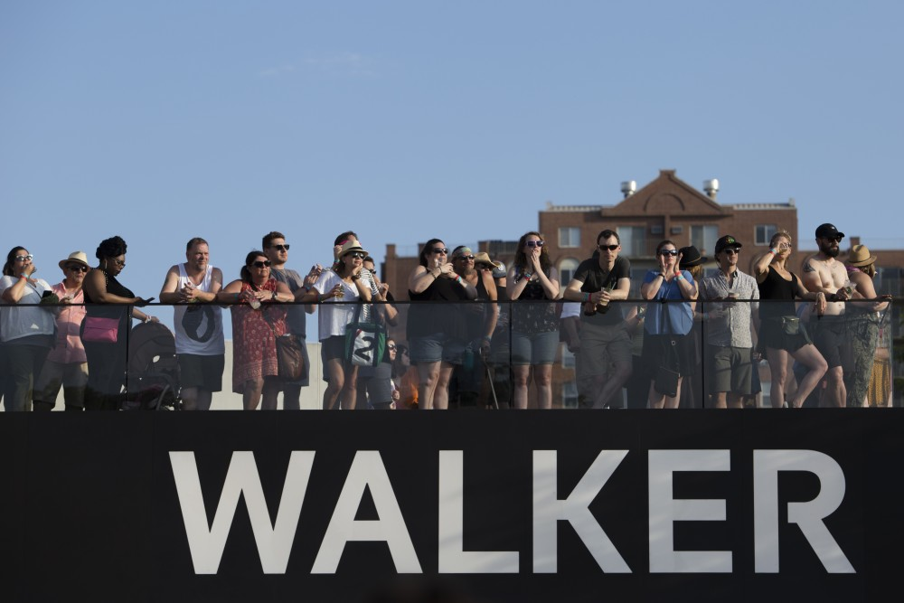 Fans stand on the patio of the Walker Art Center at Rock the Garden on Saturday, June 16.