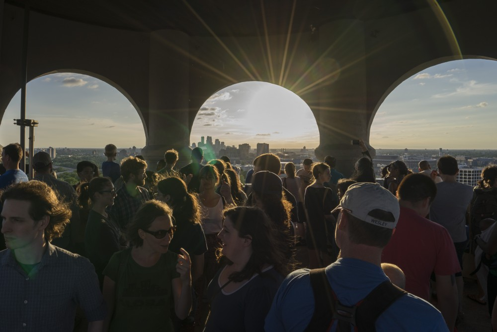 Visitors celebrate at the top of Witchs Hat Tower on Saturday, June 1. Built in 1913, Witchs Hat Tower has been a major landmark in Minneapolis for generations. New developments have been proposed near Prospect Park, and the Prospect Park Association is concerned that the height of developments will block the view from the tower.