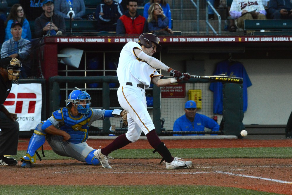 Centerfielder Alex Boxwell hits a double, increasing the lead to 12-5 during the game against the UCLA Bruins on Sunday, June 3 at Siebert Field.