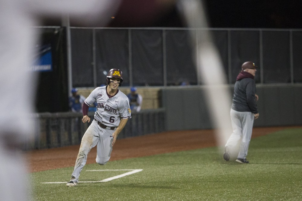 Shortstop Terrin Vavra rounds third base to score the Gopher's third and final point during the game against UCLA on Saturday, June 2, 2018 at Siebert Field. The Gophers won 3-2.