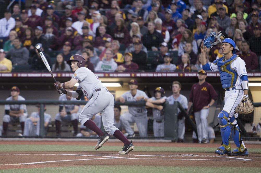 Second baseman Luke Petterson hits a single off the first pitch of the game against UCLA on Saturday, June 2, 2018 at Siebert Field. The Gophers won 3-2.