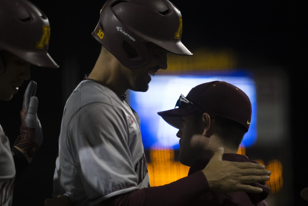 Micah Coffey is congratulated after scoring a run during the game against UCLA on Saturday, June 2, 2018 at Siebert Field. The Gophers won 3-2.