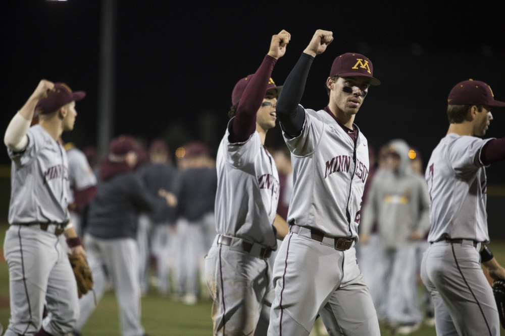 Alex Boxwell and teammates cheer after winning the game against UCLA on Saturday, June 2, 2018 at Siebert Field. The Gophers won 3-2.
