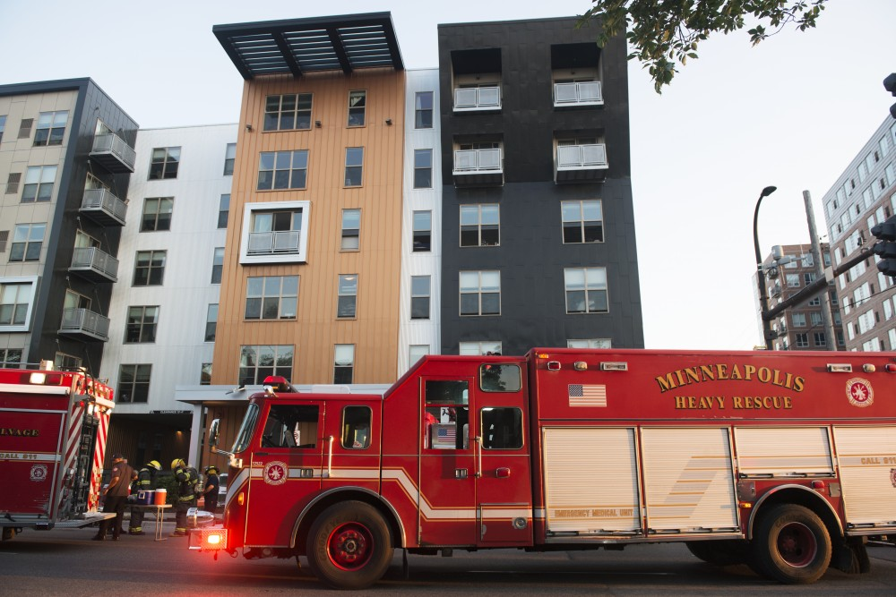 The Minneapolis Fire Department suits up to enter FloCo Fusion Apartments. The buildings were evacuated tonight due to a carbon monoxide leak.