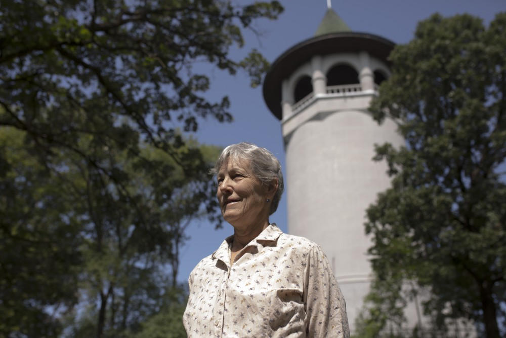 Lydia McAnerney poses for a portrait at Prospect Park Water Tower. Lydia apart of Southeast Seniors, is interviewing public members to get stories of community life in Marcy-Holmes, SE Como and Prospect Park neighborhoods.