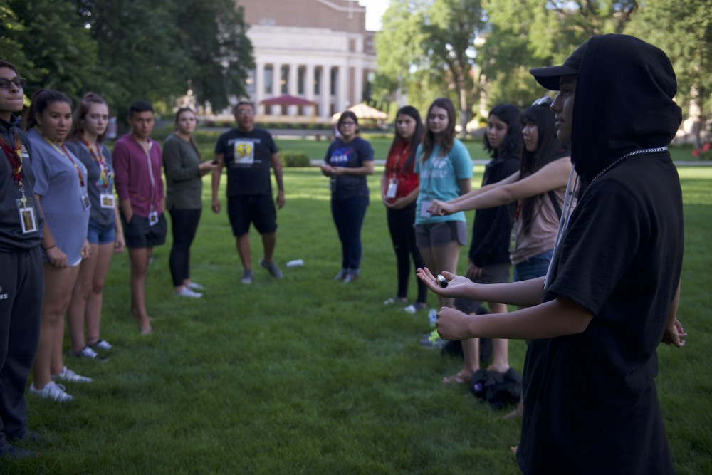 The American Indian Studies department at the University of Minnesota held its first summer camp for high schoolers to encourage them to further their education. High schoolers played a Lakota version of a handgame outside of Northrop on Tuesday, July 31, 2018.