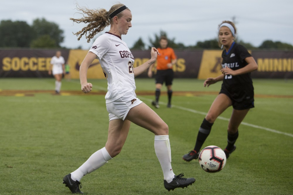 April Bockin dribbles down the field during the game against DePaul on Thursday, Aug. 30 at Elizabeth Lyle Robbie Stadium.
