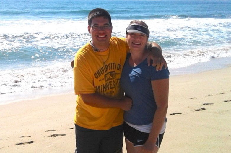 Lucas Kramer poses with his mother, Angela. Kramer, a 17-year-old Ph.D. in the College of Science and Engineering who has been attending the University since he was 11, was in a serious bicycle-vehicle accident this summer.