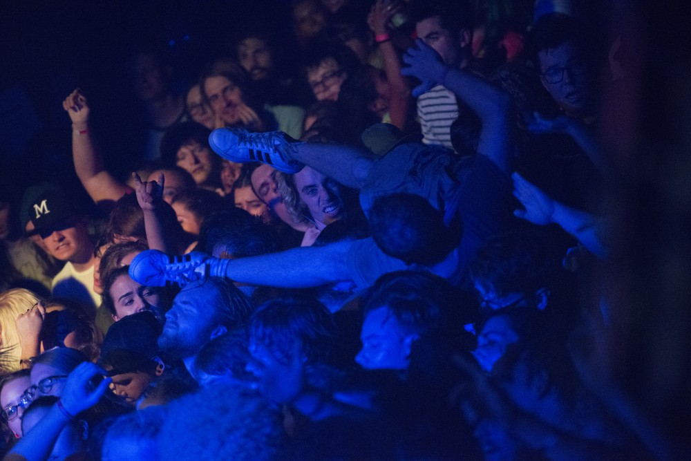 A crowdsurfer is held up during the FIDLAR show on Friday, Sept. 7 at the First Avenue Mainroom.