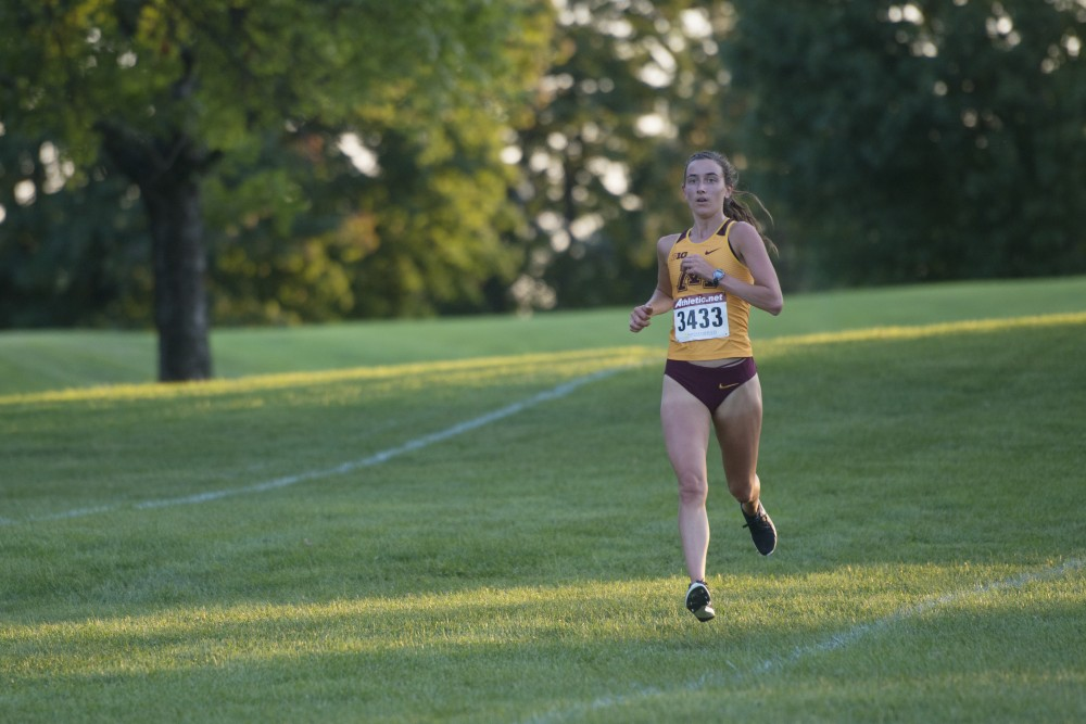 Sophomore Megan Hasz holds the lead during the Oz Memorial on Friday, Sept. 7 at the Les Bolstad Golf Course.