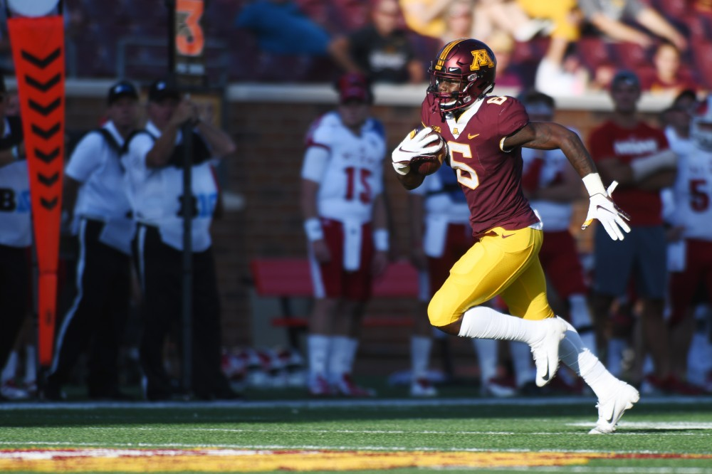 Junior Tyler Johnson runs the ball on Saturday, Sept. 14 at TCF Bank Stadium in Minneapolis.