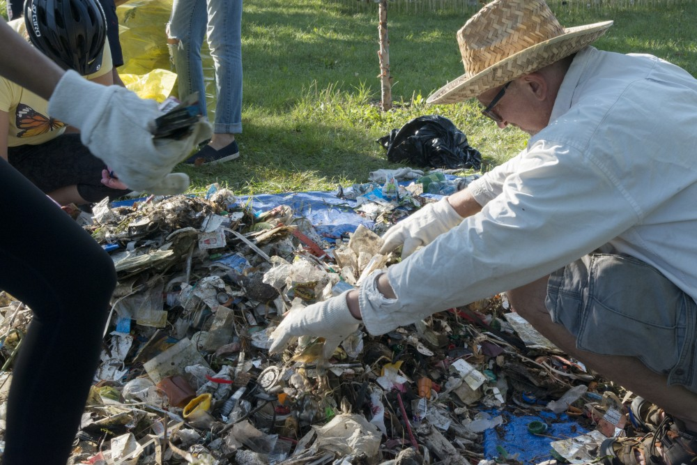 University of Minnesota Art Professor Sean Connaughty removes trash from Lake Hiawatha on Saturday, Sept 8 in Minneapolis. Connaughty has removed 5,600 lbs. of trash over the years.