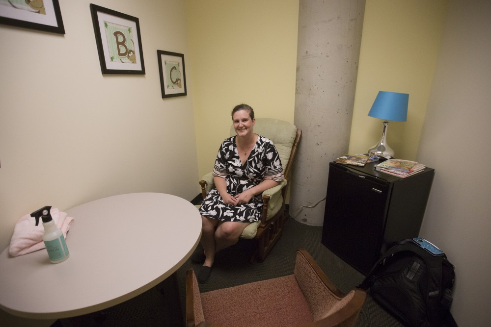 University Masters of Supply Chain Management student Katie Robertson poses for a portrait inside a lactation room on Wednesday, Sept. 12 in Hanson Hall. Robertson, the parent of a four-year-old boy and two-year-old twin boys, checked out the room weekly after her twins were born so she had a private spot to pump breastmilk in between her packed schedule.