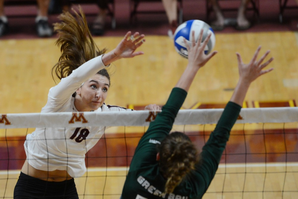 Freshman Paulina Swider jumps for the ball on Thursday, Sept. 13 at Maturi Pavilion. Gopher Women's Volleyball defeated Green Bay in three straight sets.
